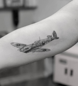 Avion Spitfire micro tattoo